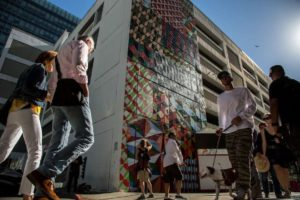 People check out the new murals during the Sites Unseen opening ceremony in San Francisco (Santiago Mejia, Special to The Chronicle, 2016)
