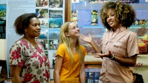 Ocean GEMS Danni Washington (right) and teen participant Catherine Orman (center) speaking with director (left) of the Mahonia Na Dari Marine Education Center in Papua New Guinea. Photo: Beth Davidow